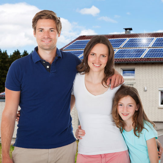 Happy-Family-in-Front-of-Solar-House
